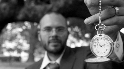 Matt Larson holding a timepiece