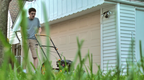 """Exasperated still from """"Mowing Through Misery"""""""
