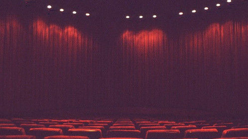 view of the curtains covering the giant 108 foot wide/35 foot high curved Cinerama screen at Omaha's former Indian Hills Theatre.