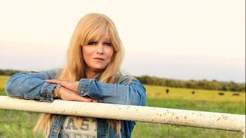 Here is a cell phone photo of International Glamour Model, International Playboy Playmate, Credited Actress , Published Author and Cattle Rancher Miss Abigail Rich at her home the Twisted R Ranch in the heart of Texas with her cows in the background.