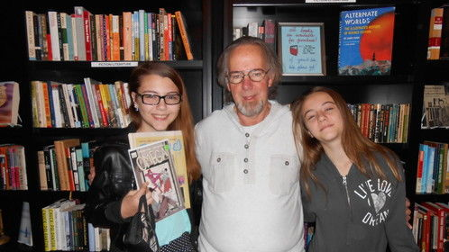 Having fun at a book signing in Nov, 2014 at The Book End located inside The Phoenix in Tulsa with granddaughters Sable (L) and Breandra (R). I'm the old guy in the middle.