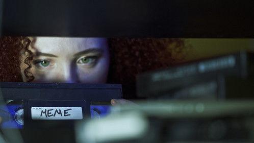 Jennifer (Sarah Schoofs) grabs the Meme tape - Promotional Still from shooting Meme January 2015