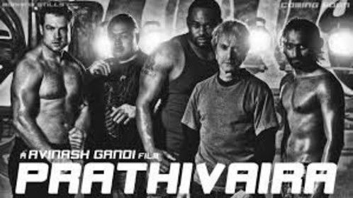 """On set photo of Fight Action's stunt fighter team posing with lead actor Prim for the film """"Prathivaira."""" From Left: Curt Cotton, Charles Maxwell (deceased), Big Spence, Durand Garcia, Prim. Not shown: Daniel Hernandez."""