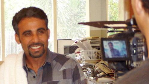 Iyad Hajjaj preps for his scene as Muslim American naturist resort owner. .  . It can happen.