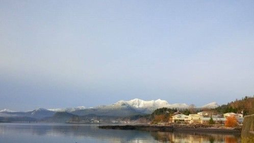 View of snowy local mountain backdrop of the Village of Queen Charlotte, Haida Gwaii, BC, Canada on Christmas Day 2015 â