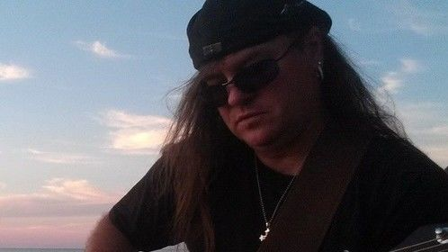Jamming out on Lake Huron in Port Austin to my song My Michigan