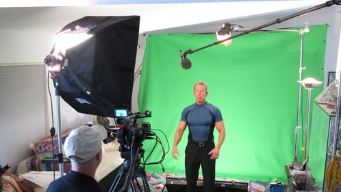Mark Schulze of Crystal Pyramid in home green screen studio for TV spot.