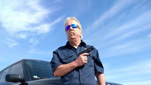 """David John McCoy as Sheriff Gator Tillson in the movie """"Rum And Hot Peppers""""."""