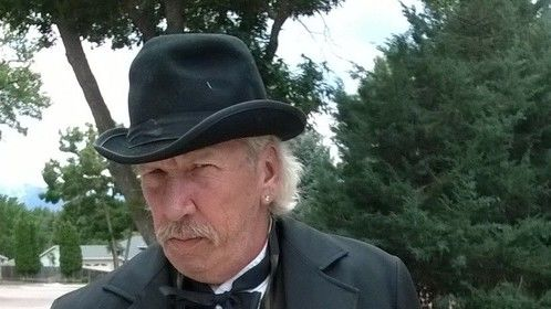 """David John McCoy as the town doctor in the movie comedy """"Heat In The West""""."""