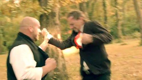 Janaj fighting off one of the Men in Black.