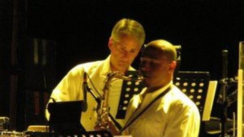 Live music with Sax player on stage.  (Holland America Line)  Actual eight (8) piece band