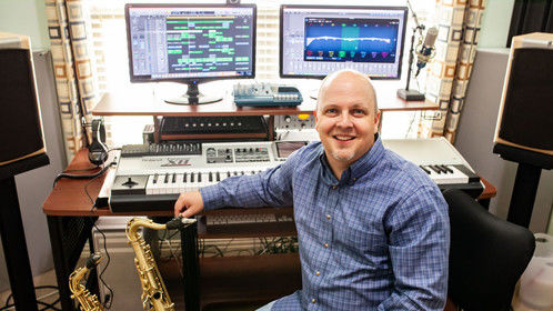 Nate Madsen in his home studio. Where he watches way too much Youtube.