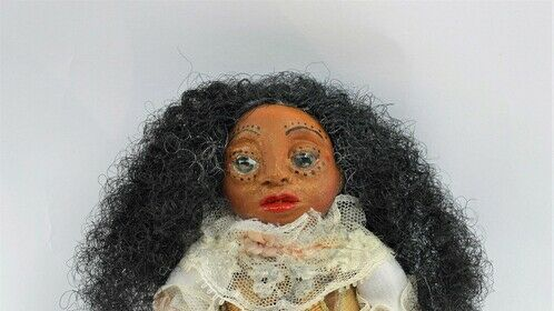 On his 16th birthday, Dr. Apples' mother was kidnapped by fairies and replaced with a doll. Each year on his birthday he receives a doll which has his mother's essence. There are 75 Dolls in his collection.   Every art doll has been handcrafted by the artist, Lacye A. Brown for the Dr. Apples franchise.