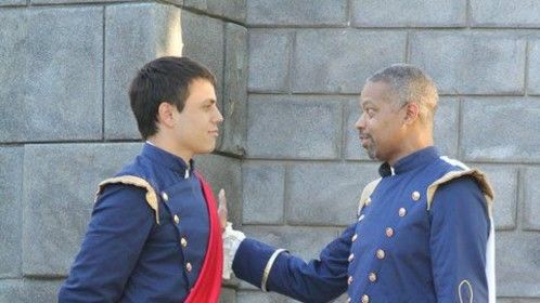 """Don Pedro coaching Claudio on how to woo the fair Hero in """"Much Ado About Nothing""""."""