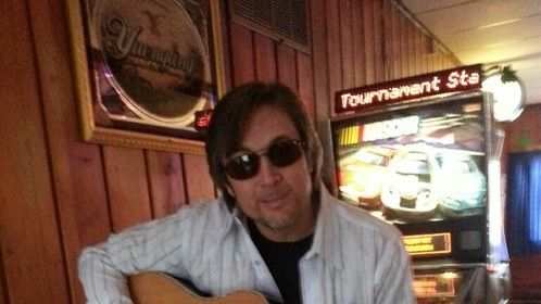 Playin around at a pub...with someone else's guitar, ha.