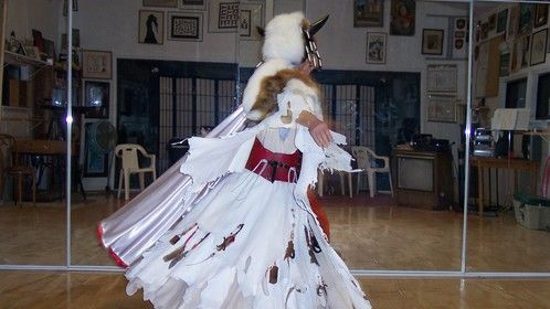 Shaman - I made about a dozen of these for HILTI Corporation in 2004 Leather, velvet, bones, beads, feathers, furs, cotton, buffalo horns...  This is taken in our dance studio - I am modeling the costume which was made for a man much taller than I.
